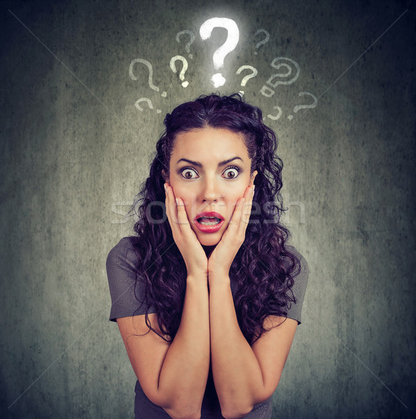 Shocked scared woman looking at camera has many questions Stock photo © ichiosea
