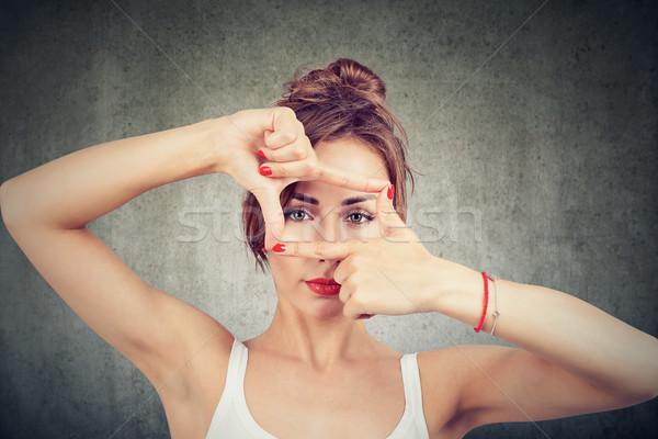 Stock photo: Woman looking through frames