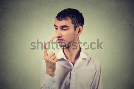 Man with long nose. Liar concept. Human face expressions, emotions, feelings. Stock photo © ichiosea