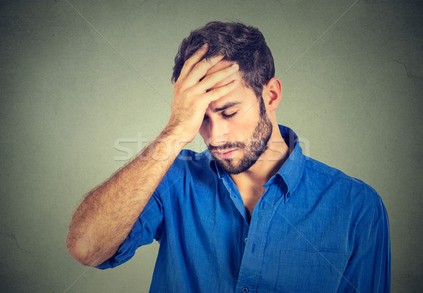 portrait stressed sad young man looking down isolated on gray wall background  Stock photo © ichiosea
