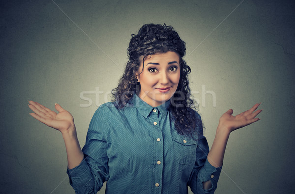 dumb looking woman arms out shrugs shoulders who cares so what I don't know Stock photo © ichiosea