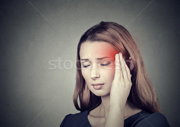 woman having headache, migraine isolated on gray wall background  Stock photo © ichiosea
