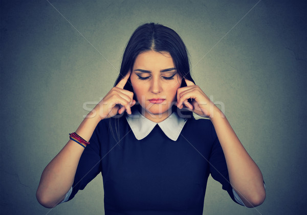 sad woman with worried stressed face expression looking down Stock photo © ichiosea