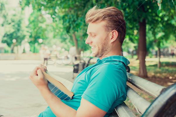 Boldog mosolyog férfi olvas könyv vicces Stock fotó © ichiosea