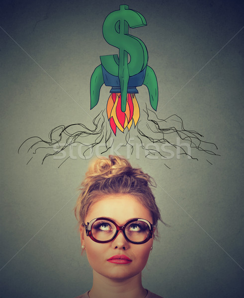 Financial business success concept. Thouhtful woman looking up  Stock photo © ichiosea