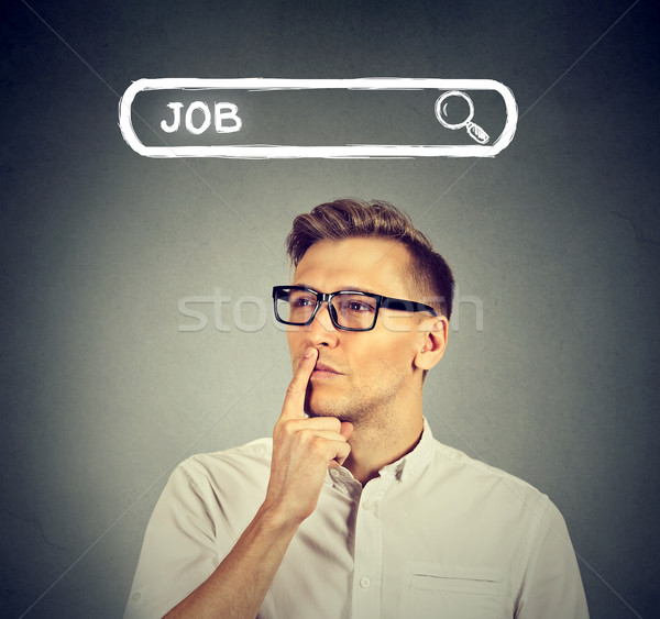 Man in glasses thinking looking for a new job  Stock photo © ichiosea