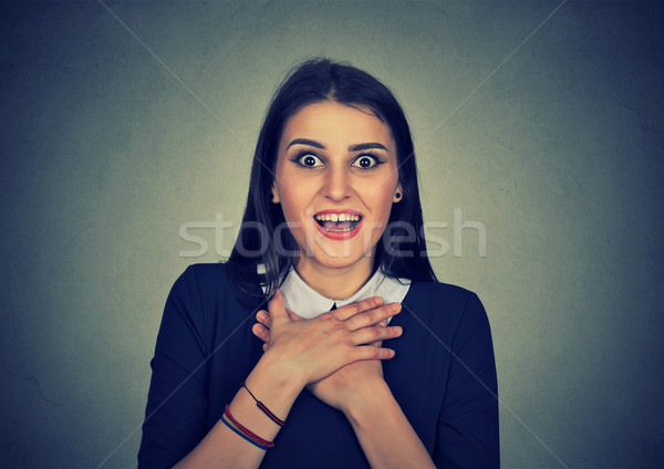 Surprised young woman shouting looking at camera Stock photo © ichiosea