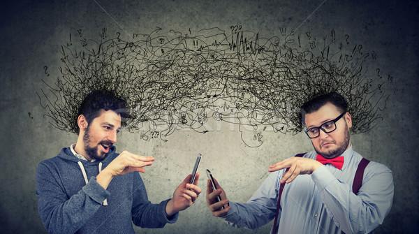 Twee mannen internet meervoudig ideeën gedachten telefoon Stockfoto © ichiosea