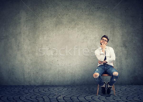 Casual man contemplating on career choice Stock photo © ichiosea