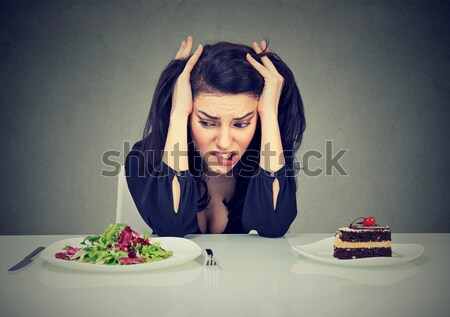 woman deciding whether to eat healthy food or sweet cookies she craving Stock photo © ichiosea