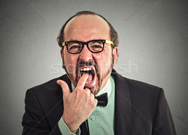 disgusted man with finger in mouth Stock photo © ichiosea