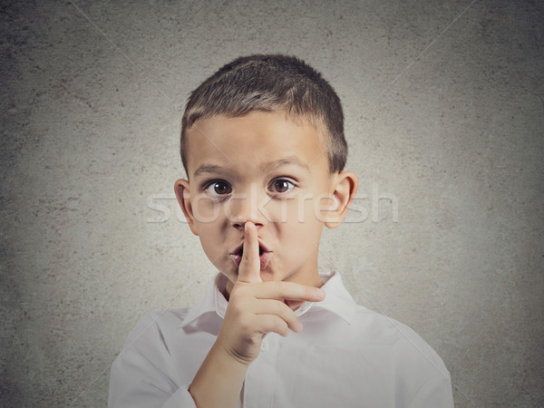 Boy placing finger on lips, quiet gesture Stock photo © ichiosea