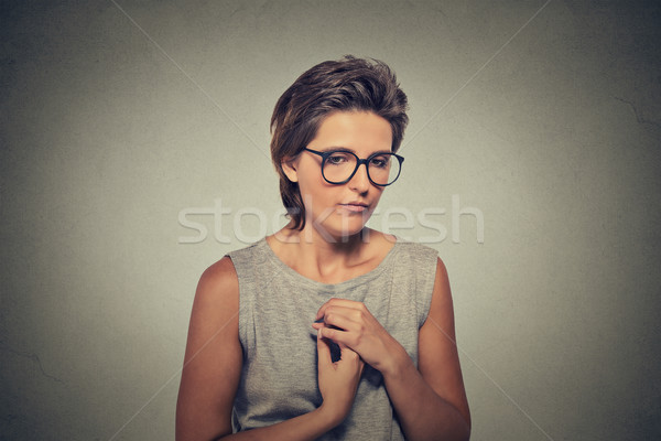 Lack of confidence. Shy young woman in glasses feels awkward Stock photo © ichiosea
