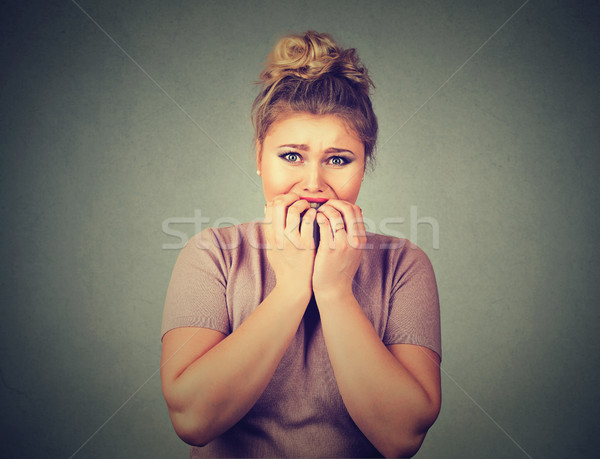 nervous stressed young woman student biting fingernails looking anxiously craving Stock photo © ichiosea