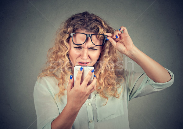 Kobieta okulary telefonu wizji problemy Zdjęcia stock © ichiosea