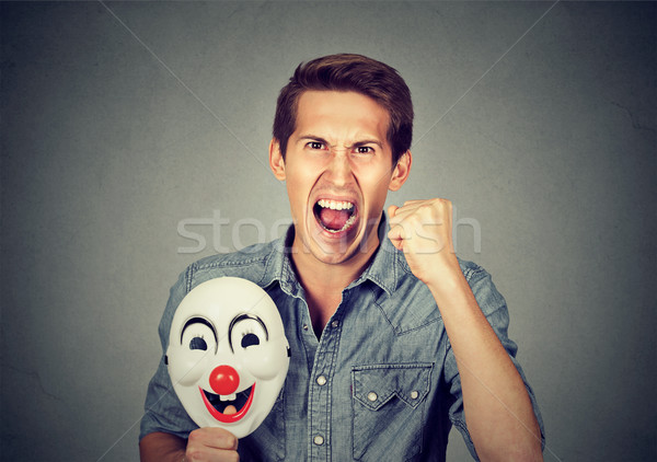 angry screaming man holding clown mask expressing cheerfulness Stock photo © ichiosea