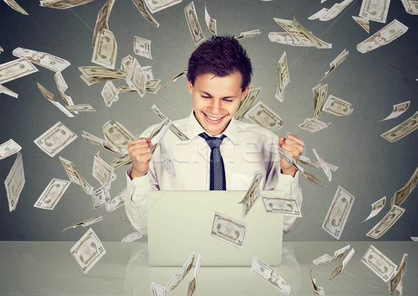 man using laptop building online business under money rain  Stock photo © ichiosea