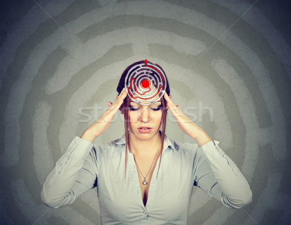 Problem solution concept. Young woman solving puzzle Stock photo © ichiosea