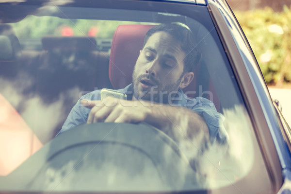 Man using cell phone texting while driving. Reckless driver concept  Stock photo © ichiosea