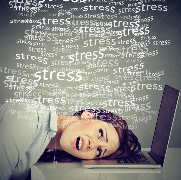 Desesperado mulher laptop pressão trabalhar Foto stock © ichiosea