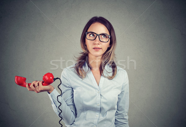 Grumpy displeased woman annoyed with unpleasant phone conversation Stock photo © ichiosea