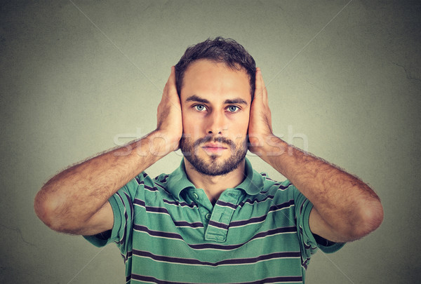 young man covering his ears with hands  Stock photo © ichiosea