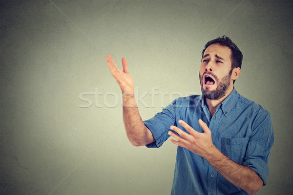 Desperate man screaming asking for help forgiveness  Stock photo © ichiosea