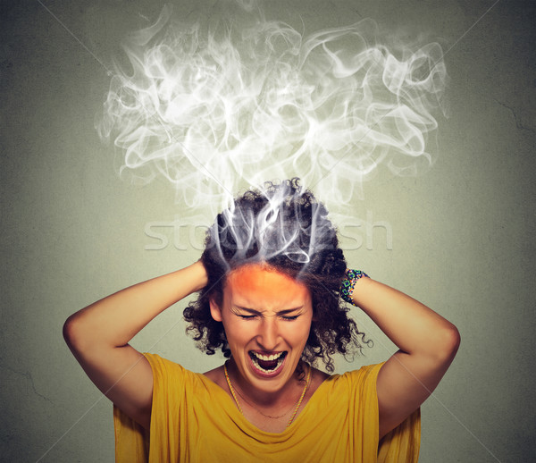 stressed woman screaming frustrated thinking too hard steam coming out of head Stock photo © ichiosea