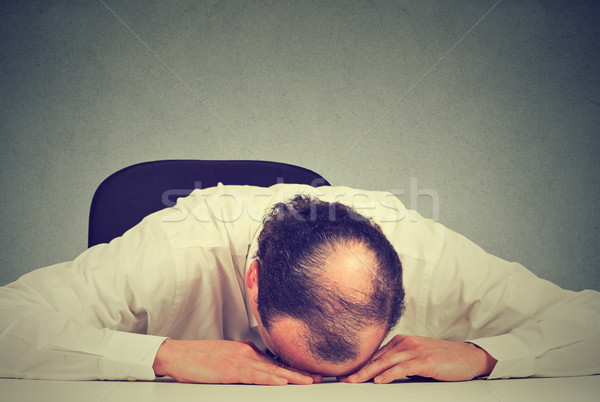 tired middle aged bald boss company employee sleeping after long working hours Stock photo © ichiosea