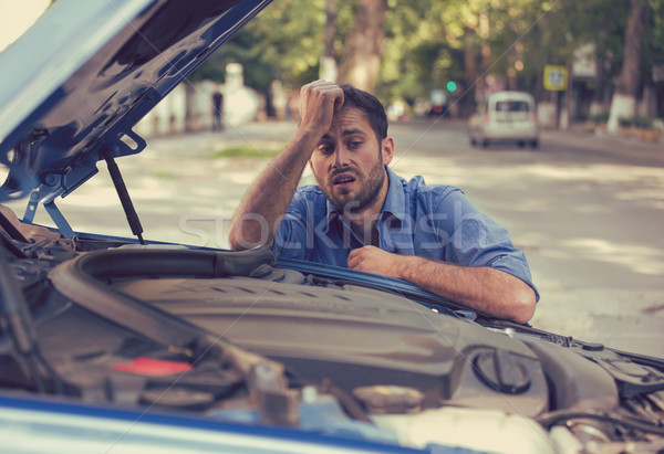 stressed man having trouble with broken car looking in frustration at failed engine Stock photo © ichiosea