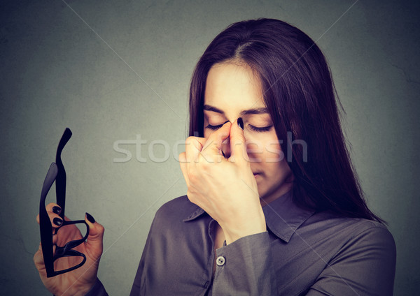 Woman with glasses suffering from eyestrain Stock photo © ichiosea