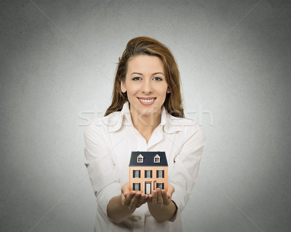 woman holding small model of house Stock photo © ichiosea