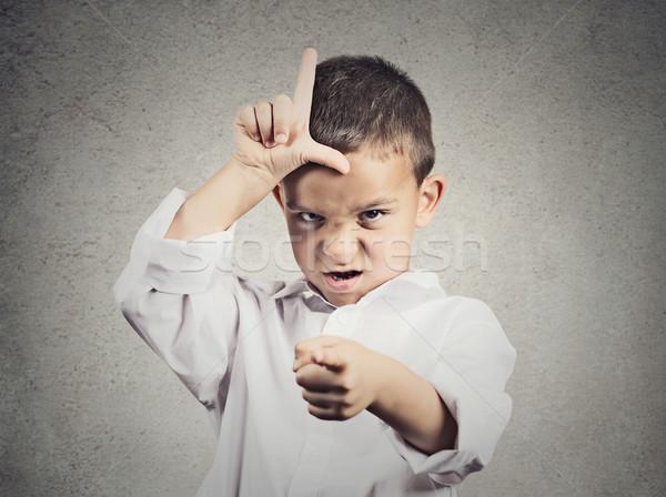 Zły chłopca przegrywający podpisania portret Zdjęcia stock © ichiosea