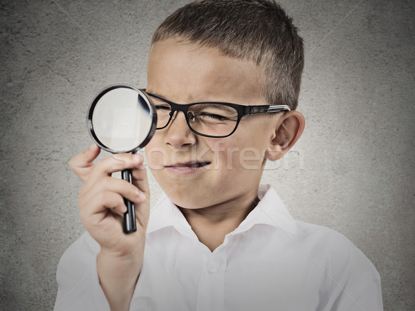 Boy looking through a magnifying glass Stock photo © ichiosea