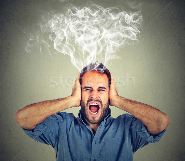 Stock photo: stressed man screaming frustrated overwhelmed steam coming out up of head