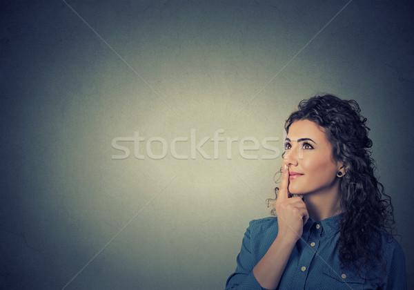 happy beautiful woman thinking looking up Stock photo © ichiosea