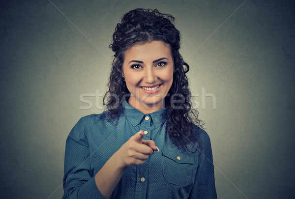 excited, happy woman smiling, laughing, pointing finger towards you Stock photo © ichiosea