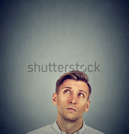Headshot confused man thinking looking up Stock photo © ichiosea