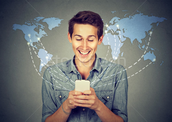 Happy man holding using smartphone connected browsing internet  Stock photo © ichiosea