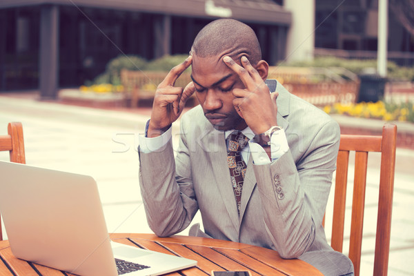 stressed businessman sitting outside corporate office  Stock photo © ichiosea