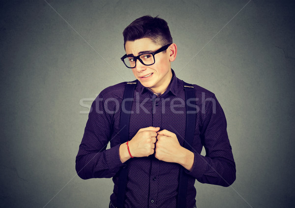 man in unpleasant awkward situation playing nervously with hands  Stock photo © ichiosea