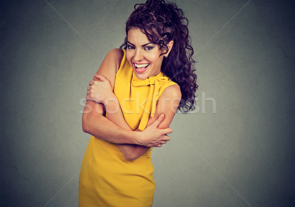 Smiling woman holding hugging herself. Love yourself concept Stock photo © ichiosea