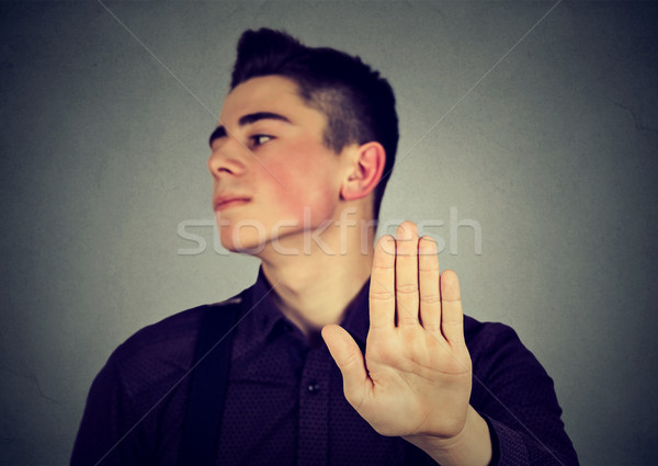 Annoyed man with bad attitude giving talk to hand gesture  Stock photo © ichiosea