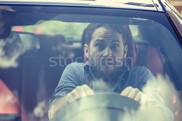 Stressed scared man driver. Inexperienced anxious motorist  Stock photo © ichiosea
