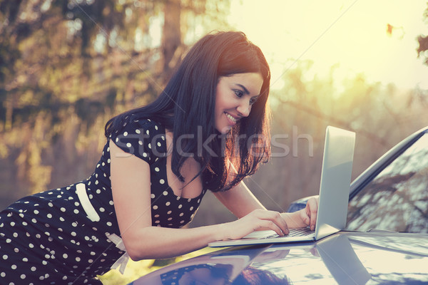 Traveler woman using laptop on car road trip reading guide map on pc Stock photo © ichiosea