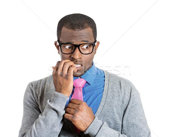 Shy man biting nails Stock photo © ichiosea