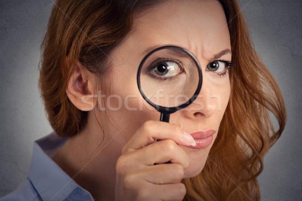 Headshot woman investigator looking through magnifying glass Stock photo © ichiosea