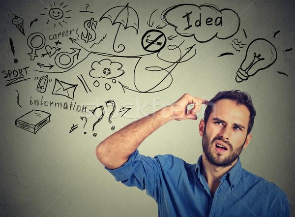 Człowiek myślenia wiele pomysły Zdjęcia stock © ichiosea