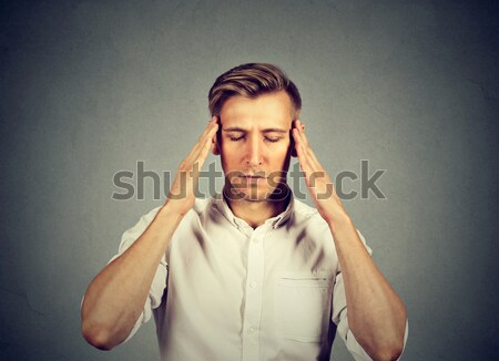 man thinking very intensely concentrating  Stock photo © ichiosea