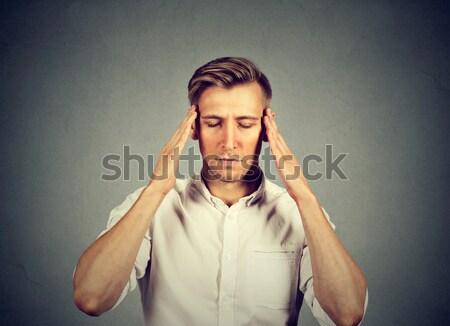 Férfi gondolkodik izolált szürke fal kezek Stock fotó © ichiosea